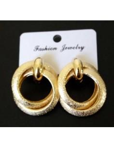Boucles d'oreilles créoles anneaux enlacées pailletées
