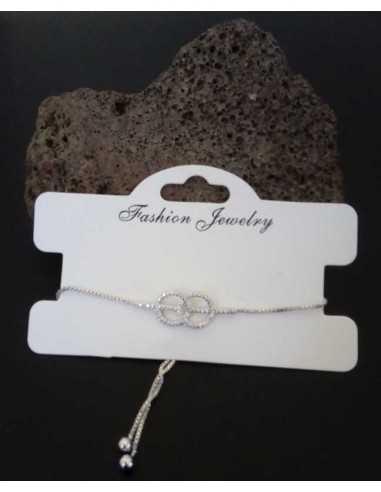 Bracelet fin motif anneaux sertis type gourmette ajustable
