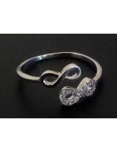 Lot de 12 bagues anneaux et doubles infinis sertis de zirconiums tailles 16 à 20