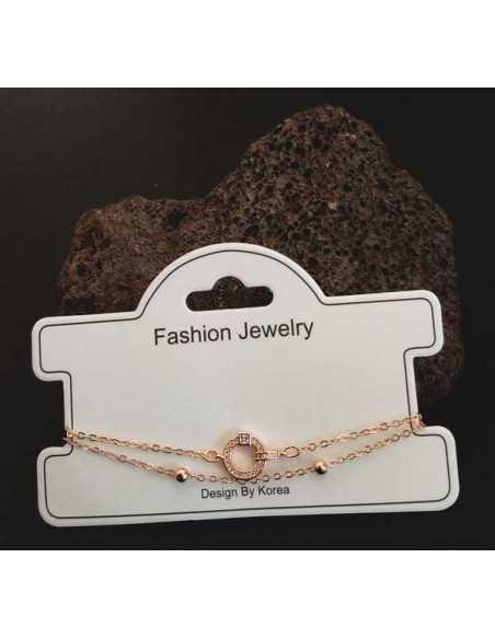 Bracelet fantaisie pendentif anneau et zircon