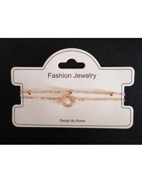 Bracelet fin double chaine motif anneau serti de zirconiums