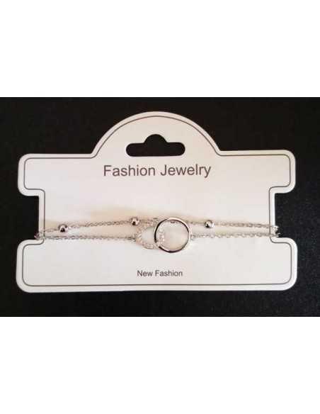 Bracelet fin double chaine motif double anneau serti de zirconiums